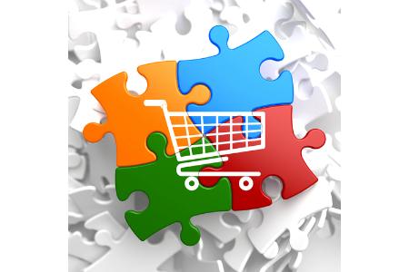 Einkaufswagen auf mehreren Puzzleteilen