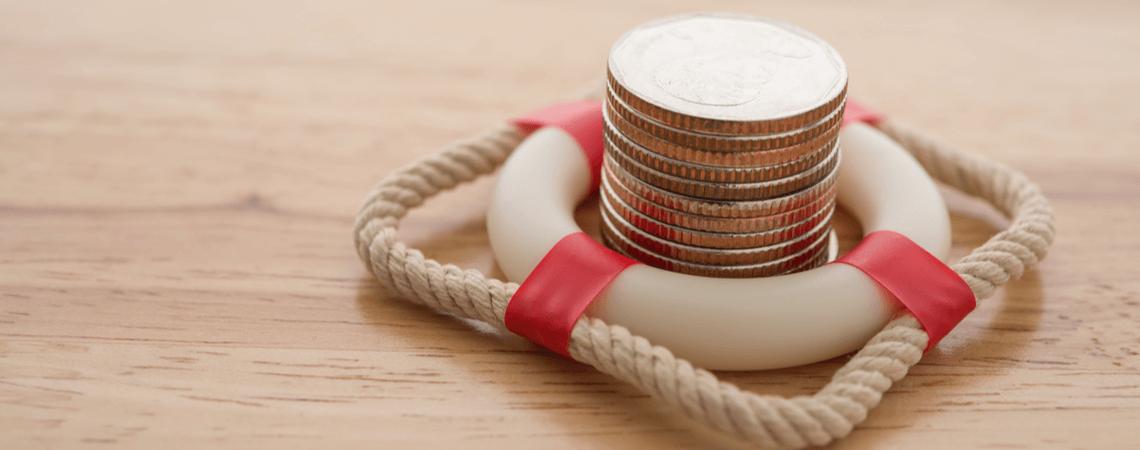 Rettungsring mit Geldmünzen